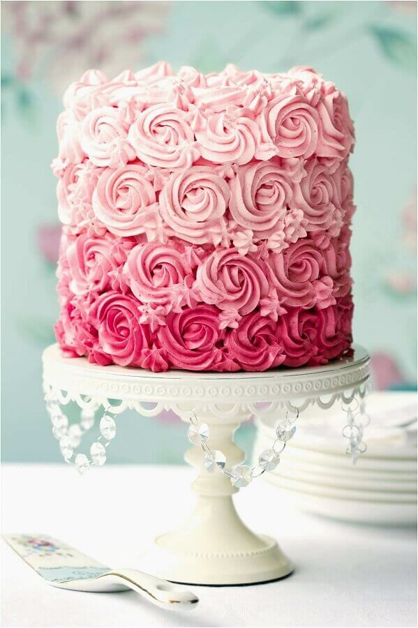 cakes decorated with pink whipped cream Photo Weddbook