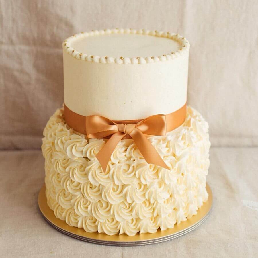 cakes decorated with whipped cream and satin ribbon Photo Weddbook