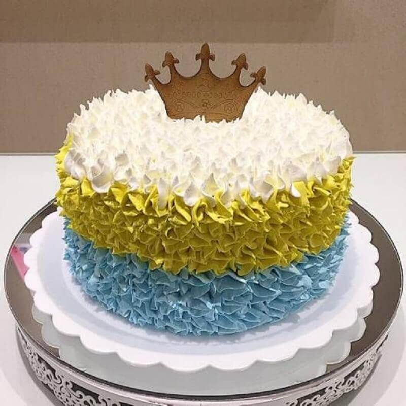 simple decorated cakes with white yellow and blue whipped cream with small crown on top Photo Air Freshener