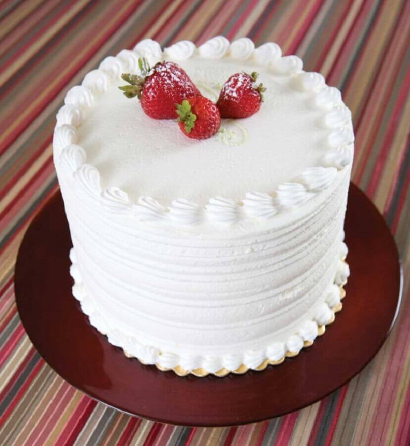 simple idea of cake decorated with strawberry and whipped cream Photo Decorated Cakes