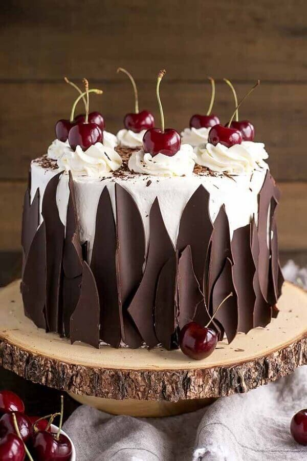 chocolate cake decorated with whipped cream and cherries Foto Food Porn Diary