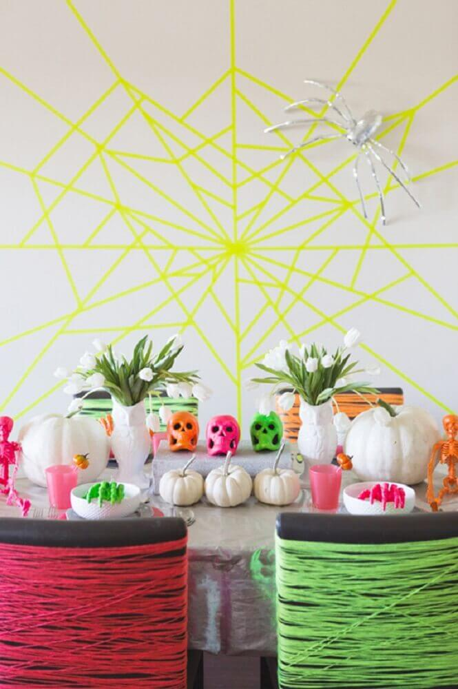 Halloween party decorated with neon details Photo Brit + Co