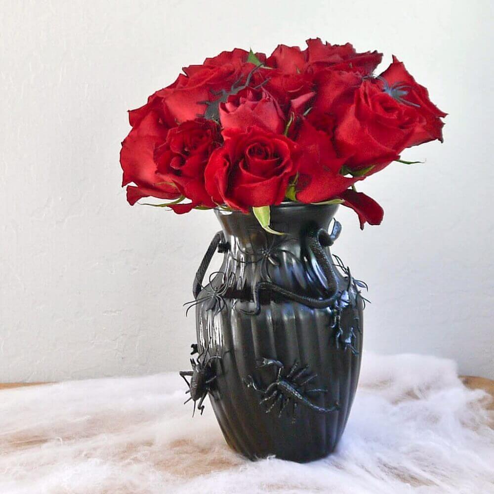 black vase with red rose arrangement for Halloween Photo Popsugar