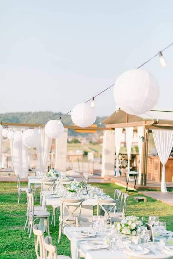 outdoor wedding party decorated with white flower arrangement Wedding Chicks