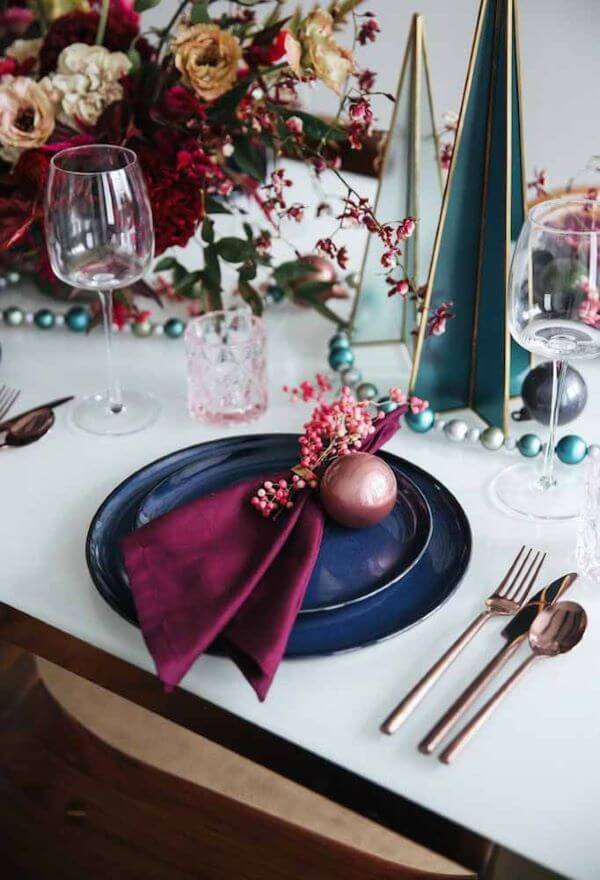 Christmas table decoration with blue and marsala