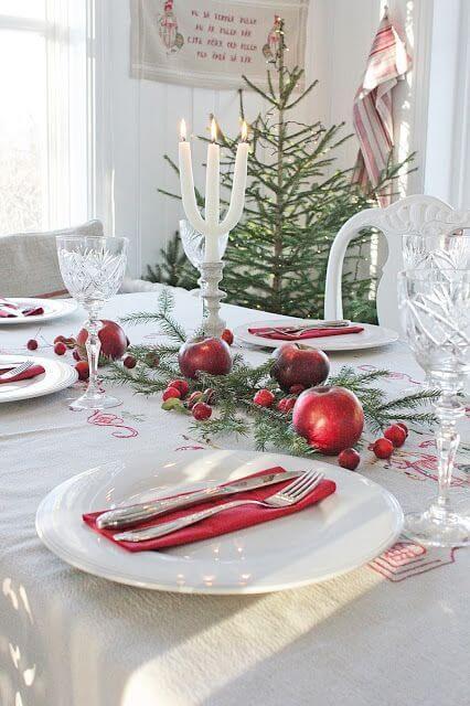 Table decorated with red fruits