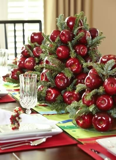 Christmas dinner table decoration with fruit