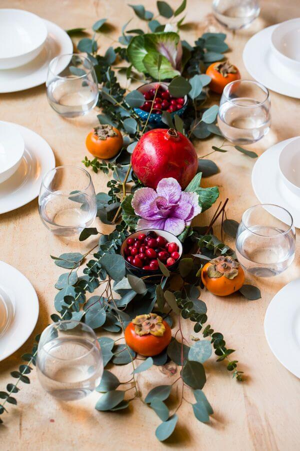 Christmas table decorated with fruit and flowers