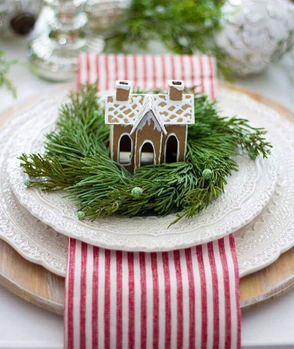 Christmas table with beautiful decorations on the plate