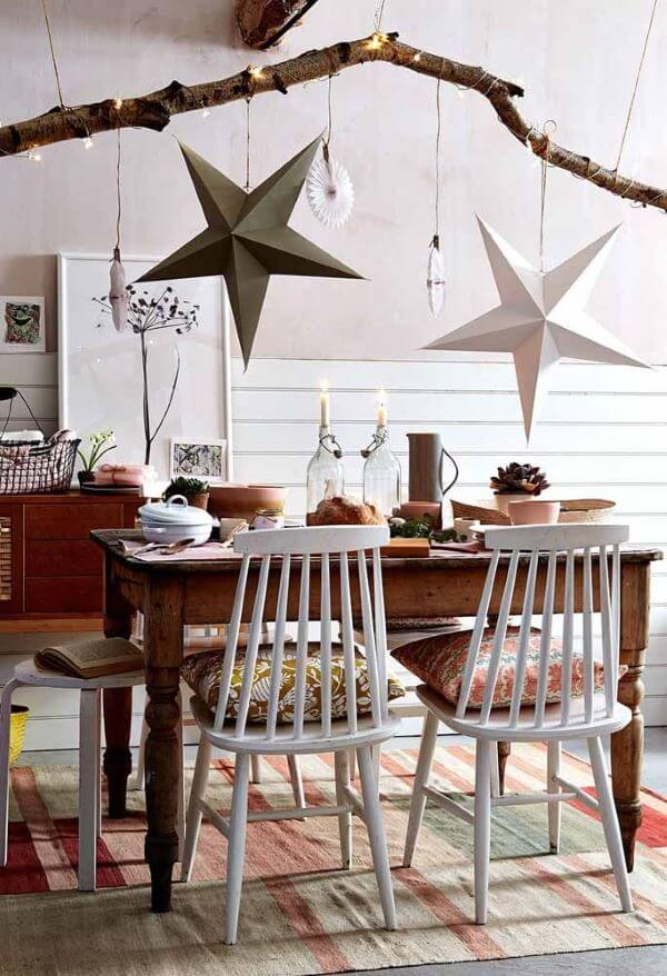 Simple Christmas table with stars on the ceiling