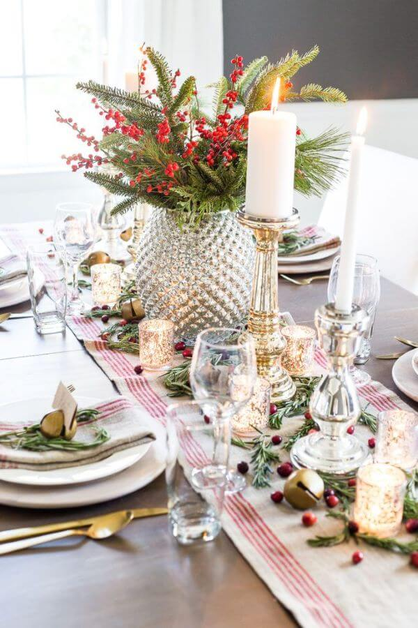 Christmas table with centerpiece with candles and flowers