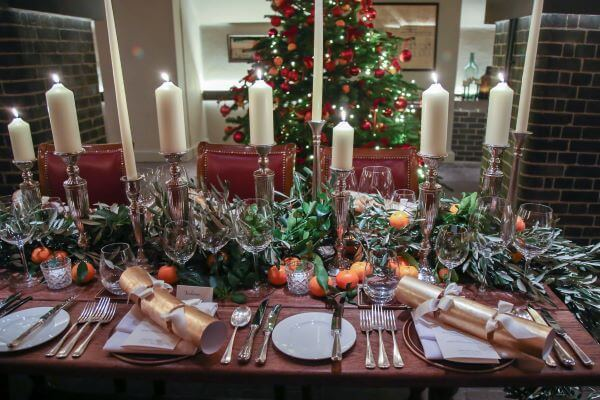 Christmas table with candles and fruit
