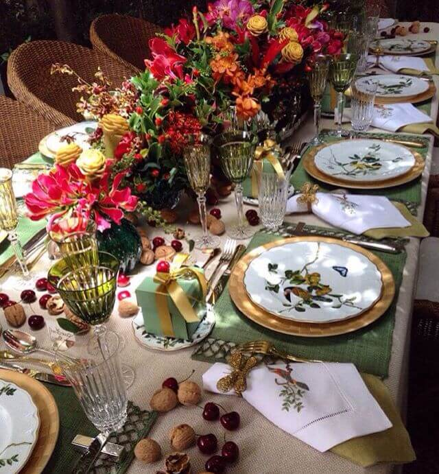 Table decorated with many flowers and delicate dining appliance