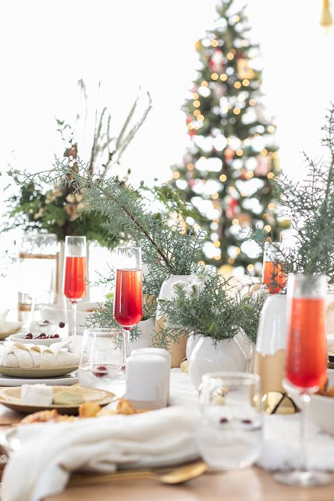 Christmas table decorated with pots of plants