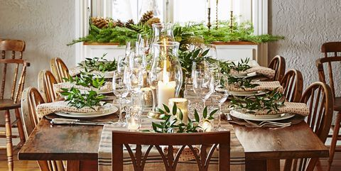 Christmas table with candles and bowls