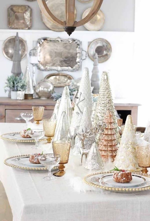 Simple Christmas table with different golden trees