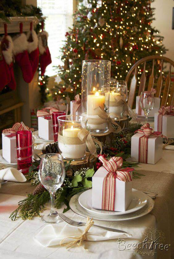 Christmas table arrangements and candles with decorating gifts