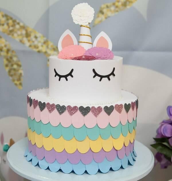 Unicorn fake cake enchants table decoration