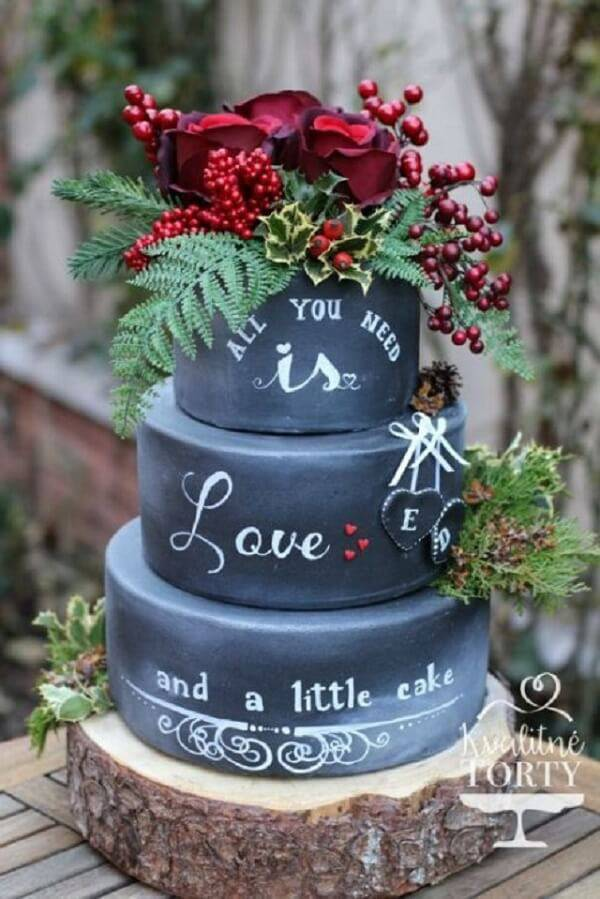 Cake with black fake bottom and red flowers on top