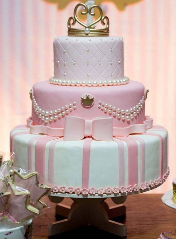 15-year-old fake cake in shades of pink, white and gold