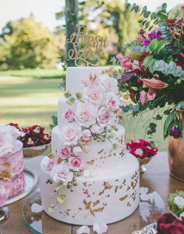 15 year old fake cake with flower cascade