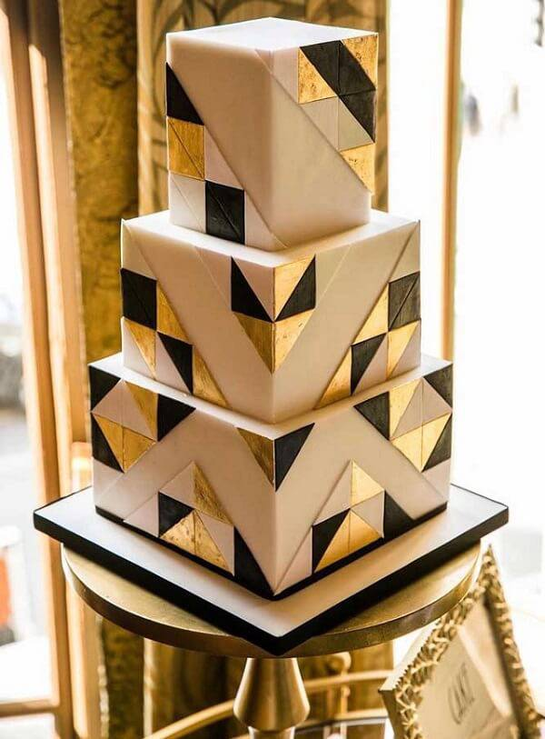 Rustic fake cake with futuristic design receives geometric shapes