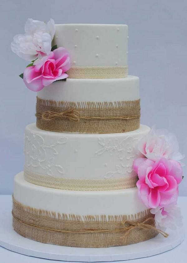 Rustic fake cake with sisal and flower finishing