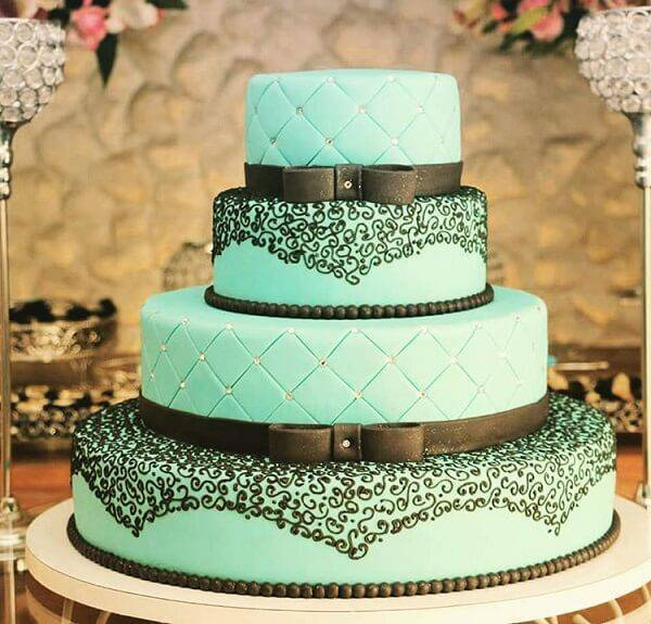 Super delicate 15 year old fake cake made in shades of black and blue