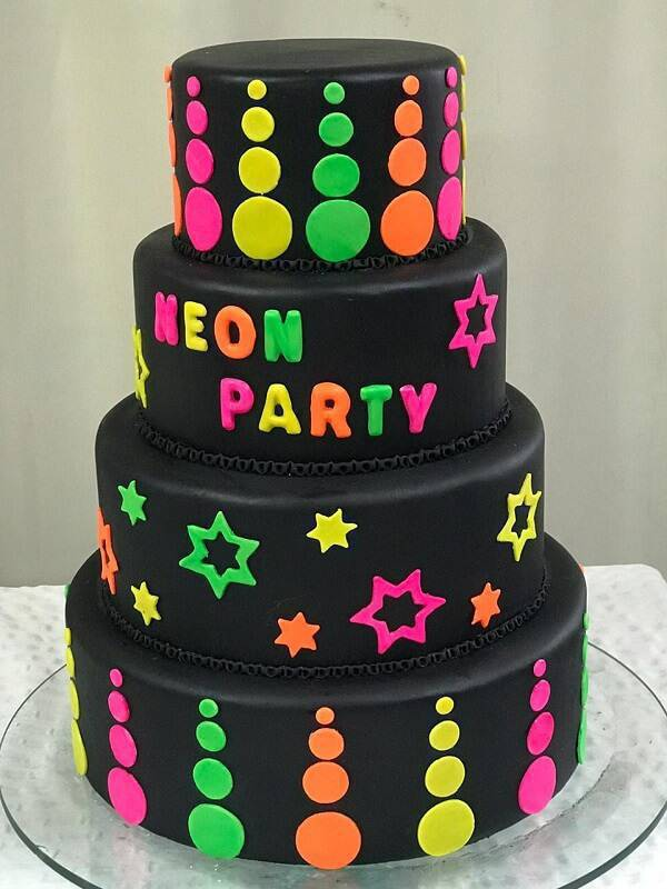 15-year-old fake cake with black background and neon shades