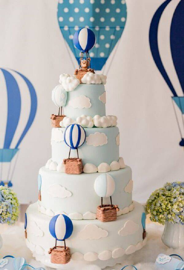 Cake with fake structure made with clouds, balloons and bears