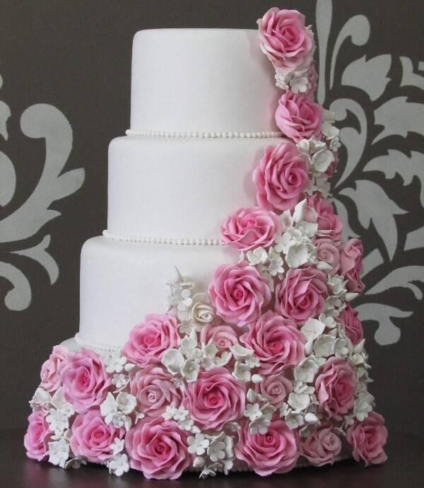 Fake wedding cake with white background and flower finish