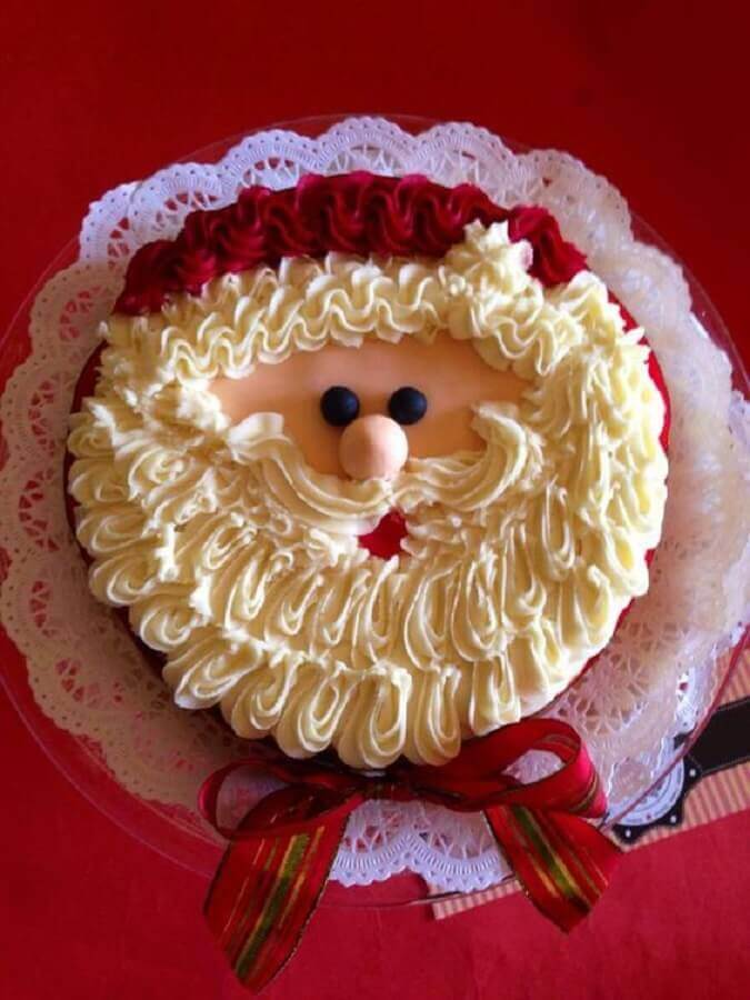 Christmas cakes decorated with whipped cream and Santa Claus' face Foto Pinosy
