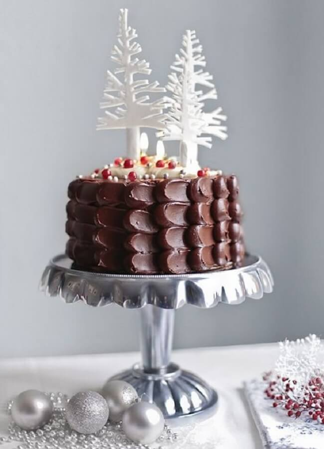 simple chocolate christmas cake with white pine trees on top Photo CakesIdeas