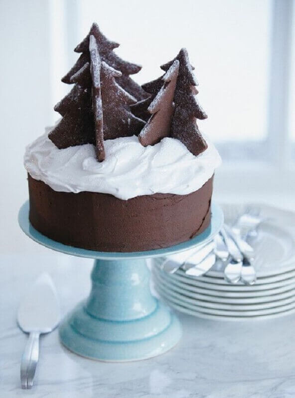 Christmas cakes decorated with whipped cream and chocolate pines Photo Why Santa Claus
