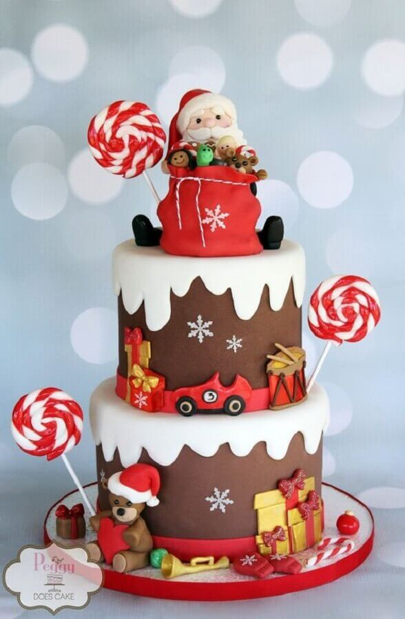 beautiful christmas cake decorated with american children's folder Photo Peggy Does Cake