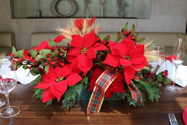 Arrangement formed with Christmas flower