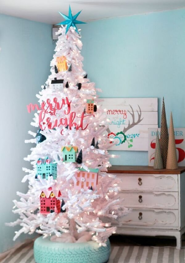 The colorful decorations stand out even more in the white Christmas tree