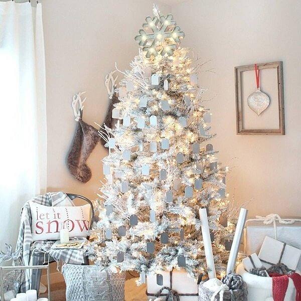 White Christmas tree illuminated and adorned
