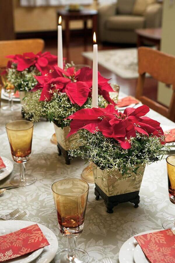 Christmas flower with candle decorates the dinner table
