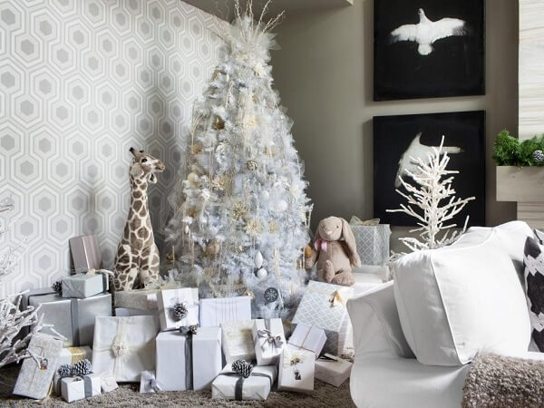 Living room decorated with white Christmas tree