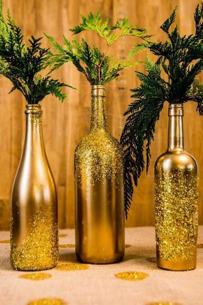 Painted wine bottles can become beautiful Christmas decorations