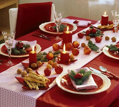 Christmas dinner table with nuts and fruits Photo by Zajenata
