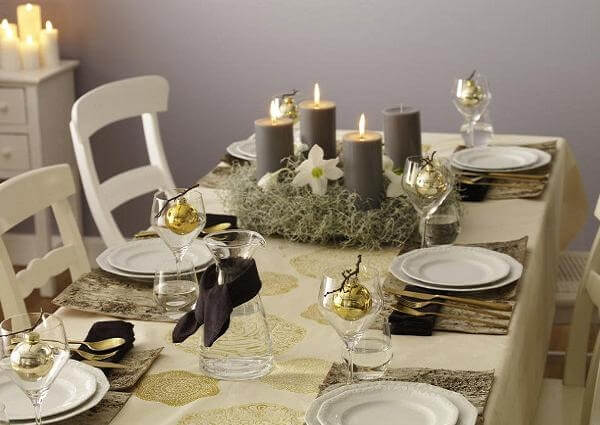 Simple Christmas dinner table with grey candles Photo by DIY Crafts