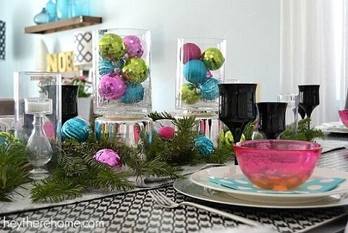 Christmas dinner table with colored Christmas balls Photo by Hey There Home