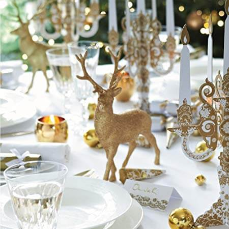 Golden ornaments on Christmas dinner table Photo from Amazon