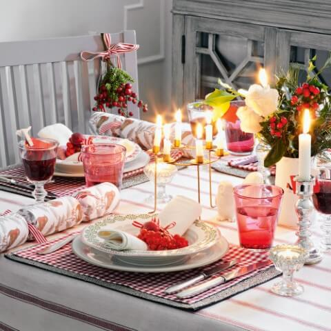 Candles of different sizes on Christmas dinner table Photo by Ideal Home