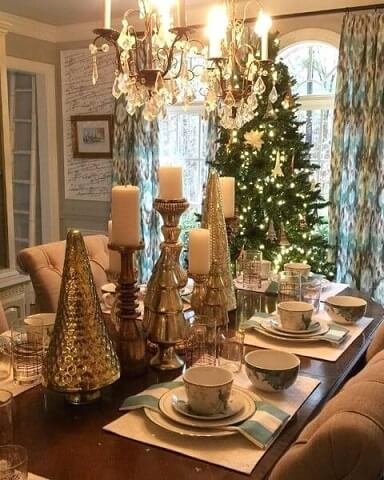 Golden table decorations for Christmas dinner Photo by Nestled