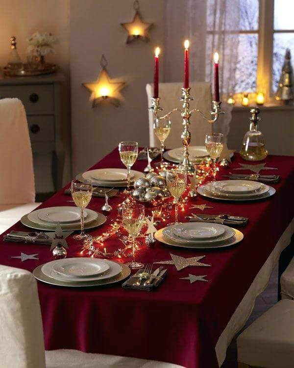 Wine tablecloth and golden candelabra Photo by North Mallow