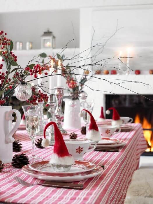 Mini Christmas hats as a Christmas dinner table decoration Photo by Weddingomania