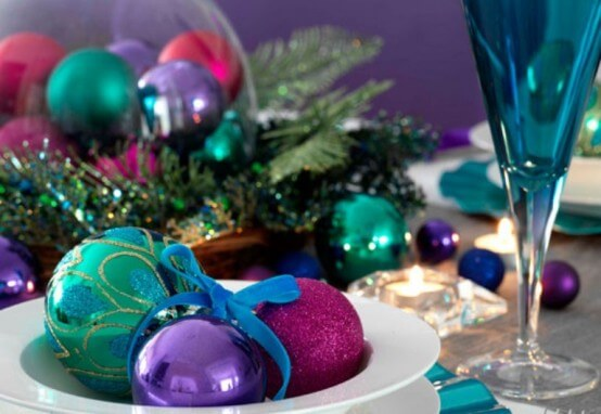 Christmas balls in shades of green and purple Photo by DigsDigs